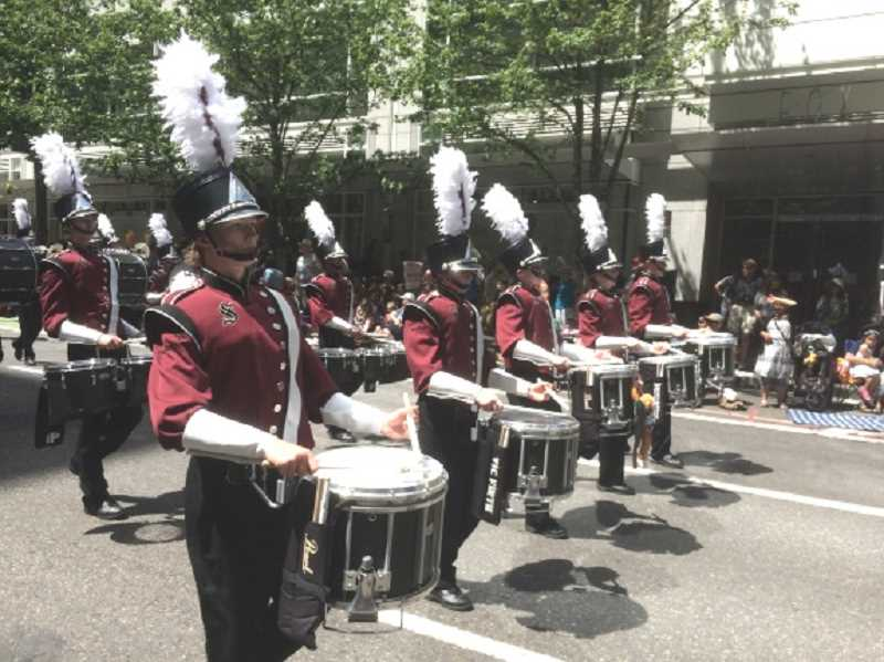 COURTESY OF BRANT STAI - Sherwood High School's drum line, performing with the marching band in the Grand Floral Parade in June, enjoyed a very successful season this past year.