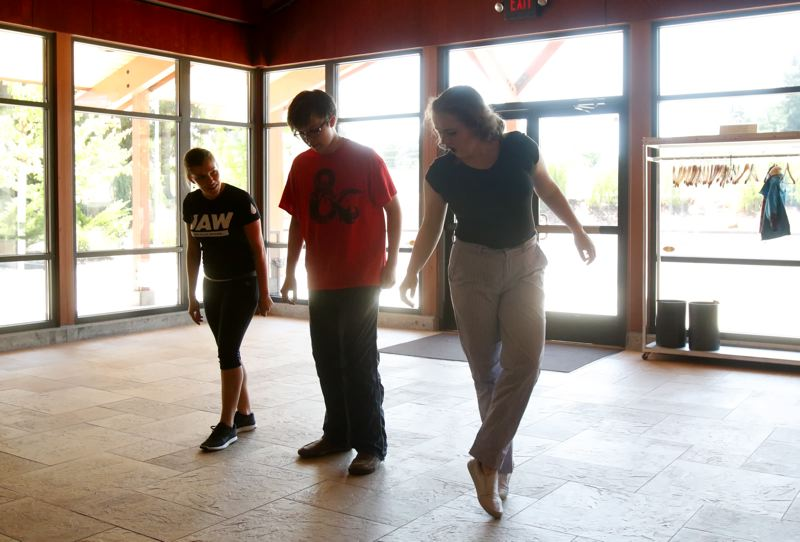 TIMES PHOTO: JONATHAN HOUSE - Jamie Lee Hammond helps teach dance steps to William Britton and Fiona McInnis for the Broadway Rose Teen Summer Workshop production of 'The Wizard of Oz.'