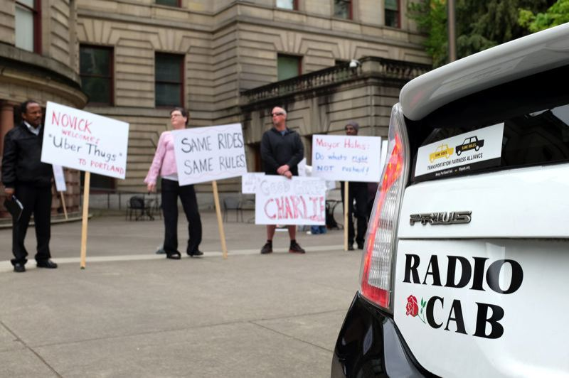 TRIBUNE FILE PHOTO  - Taxi drivers demonstrate outside City Hall as the Portland City Council considers pilot project to allow the entry of Uber and Lyft into the taxi market.