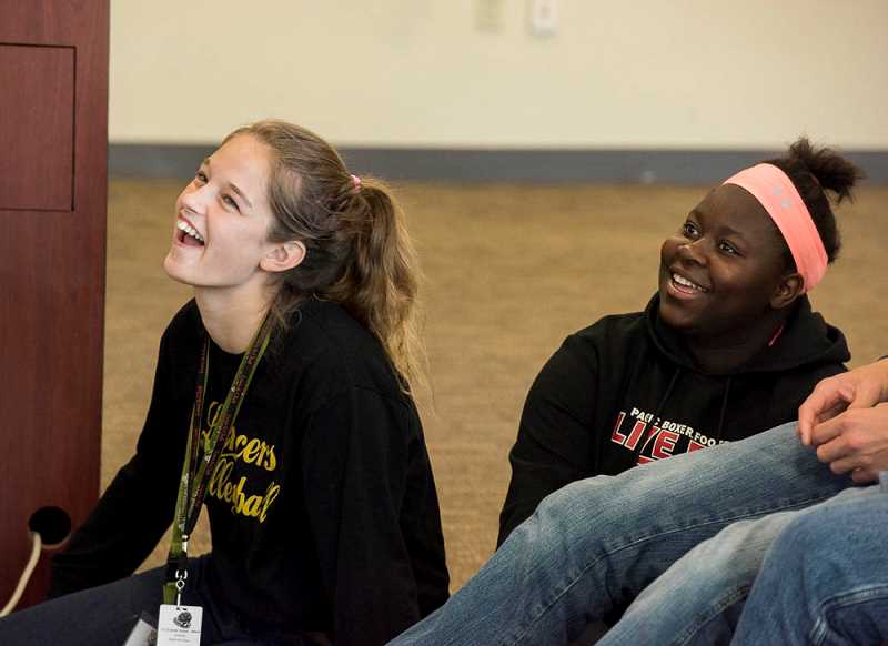 SUBMITTED PHOTO: BOB KERNS - Students MacKenzie Davis of South Umpqua High School in Myrtle Creek, left, and Lovetie Musick from Taft High School in Lincoln City enjoy an activity at Warner Pacific College during GEAR UP camp.