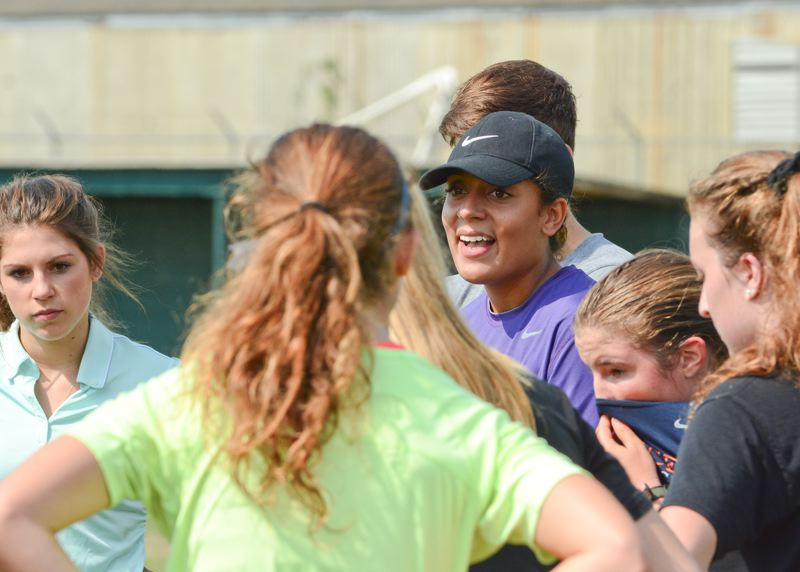 JOHN WILLIAM HOWARD - Rebekah Kurle talks with her new team after a training session on Wednesday, Aug. 12. The position is Kurle's first head coaching job.