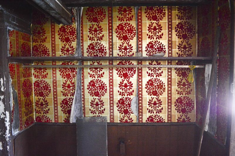 JOHN WILLIAM HOWARD - Ornate crimson and gold wallpaper is still in good shape on the upper deck near the stern of the boat, where wait staff likely kept extra dishes and silverware for dining guests. The woodwork around the alcove in each direction has collapsed.