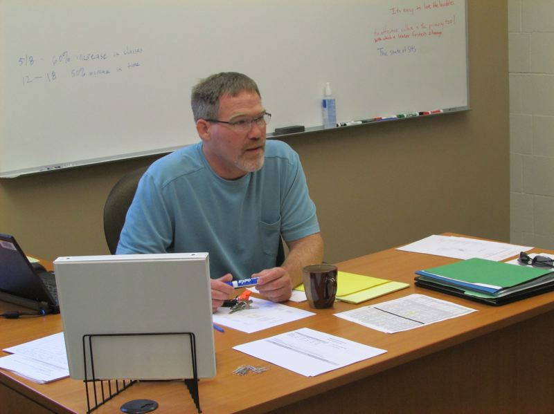 SPOTLIGHT PHOTO: MARK MILLER - Principal Jim Jones speaks with one of his staff members (out of frame) in his new office at Scappoose High School on Monday, Aug. 17.