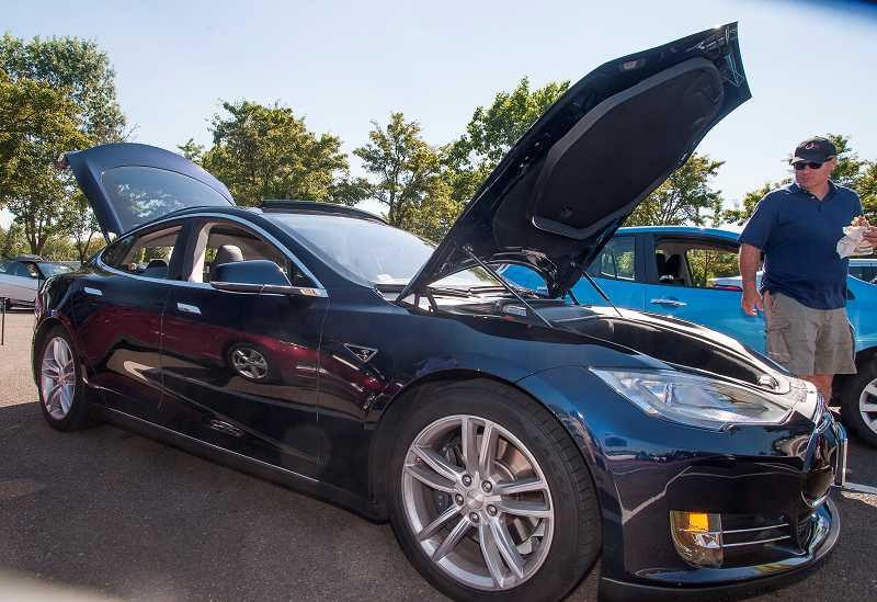 SPOKESMAN FILE PHOTO - A Tesla Model S owned by Portland resident Doug Bullard drew swarms of visitors at the 2014 National Drive Electric Week EV exhibition at Lamb's Thriftway in Wilsonville.