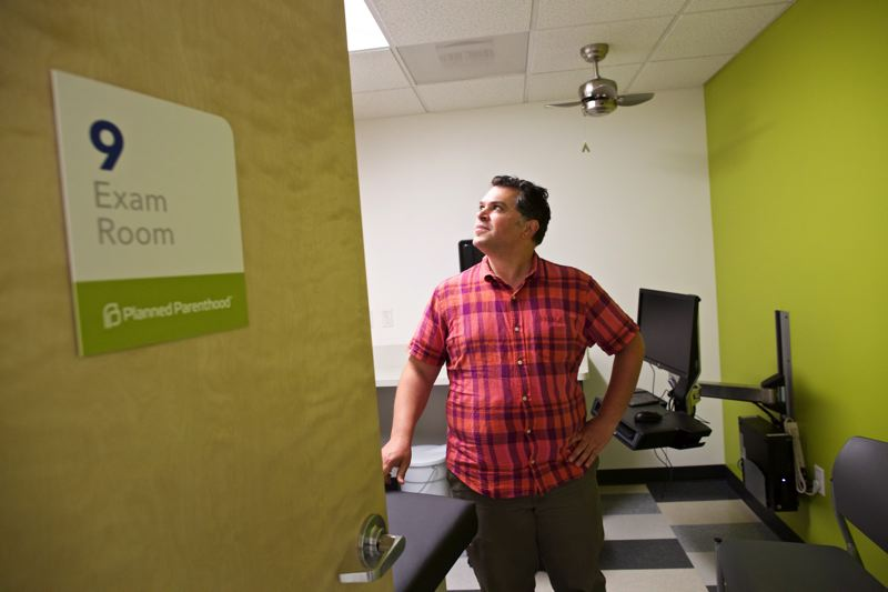 TRIBUNE PHOTO: JAIME VALDEZ - Jimmy Radosta, communications and marketing director for Planned Parenthood Advocates of Oregon, stands in the new Planned Parenthood Milwaukie-Oak Grove Health Center.