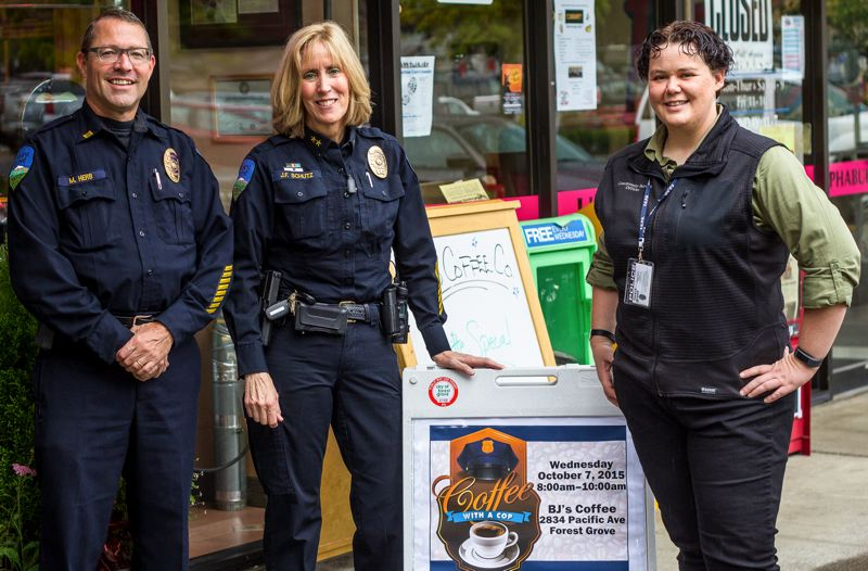 NEWS-TIMES PHOTO: TRAVIS LOOSE - New Community Outreach Specialist Lauren Quinsland (right) attended the Forest Grove Police Department's Coffee with a Cop event last Wednesday with Capt. Mike Herb and Chief Janie Schutz, who described Quinsland as 'a smart lady who can read people very well.'