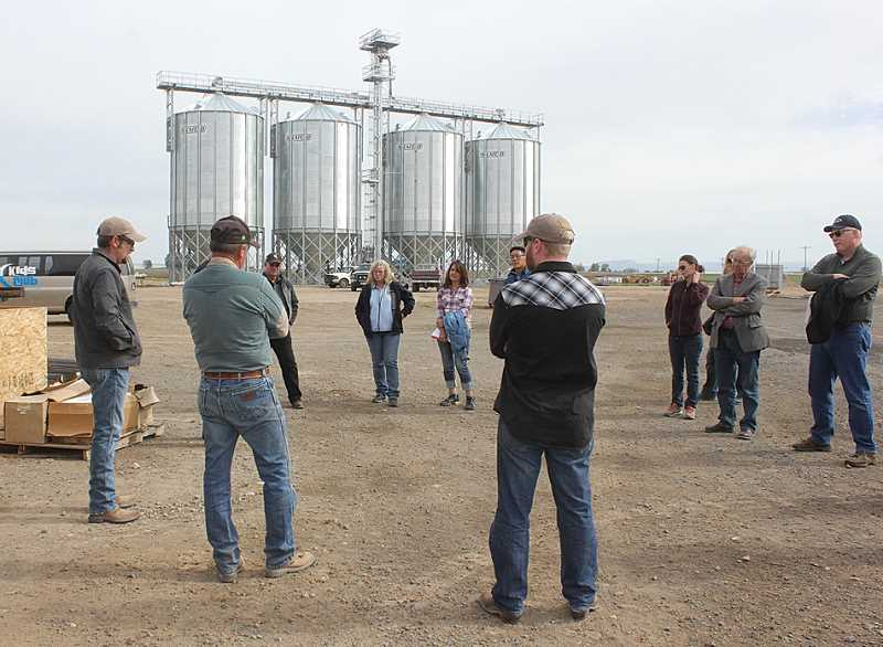 SUSAN MATHENY - Farmers Seth and Brad Klann, from left, talk to the tour group about their startup estate barley malting operation near Mecca Grade.