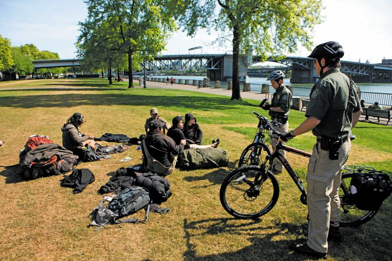 TRIBUNE PHOTO: CHRISTOPHER ONSTOTT - Park rangers now patrol city parks that police once patrolled. Observers say the city has become more tolerant of campers in parks this year. summer.