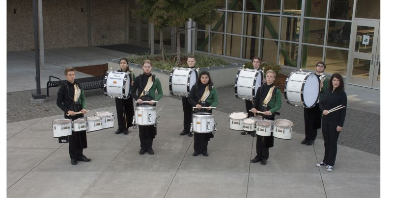 SUBMITTED PHOTO - Director Rene Ormae-Jarmer, right, leads the Rex Putnam High School Kingsmen Thunder drum-line program.