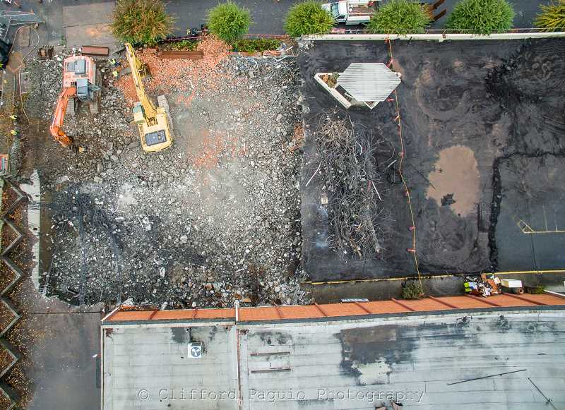 CLIFFORD PAGUIO/FOR THE REVIEW - Oct. 28, 2015: Looking straight down on the Wizer Block, where crews are stripping asphalt away from the concrete parking lot, making it easier to crush and recycle the concrete.