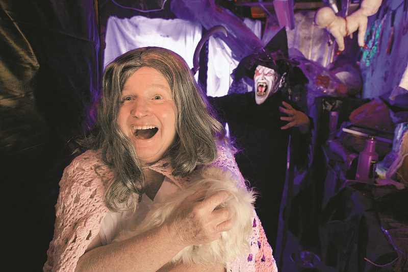 TIMES PHOTO: JAIME VALDEZ - Jan Velardi, foreground, and Suzanne Parker, rehearse their scare tactics in a haunted house in the garage of Parkers home. Velardi and Parker who are next door neighbors, annually host a haunted house for those looking for a thrill.