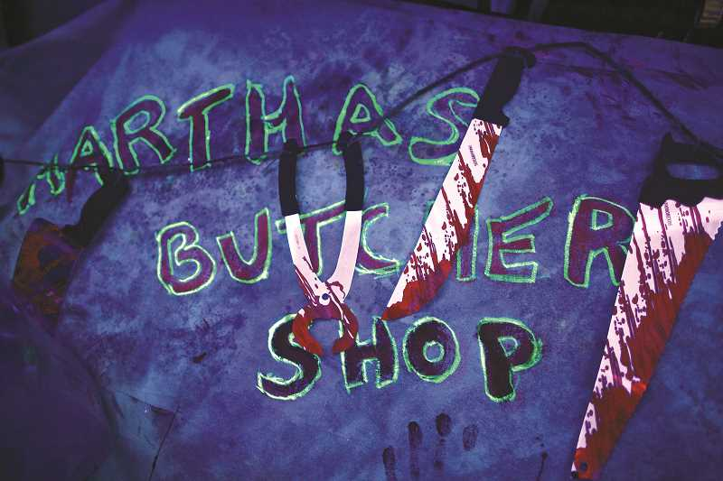 TIMES PHOTO: JAIME VALDEZ - Marthas Butcher Shop is one scene in the haunted house hosted by next-door neighbors Jan Velardi and Suzanne Parker.