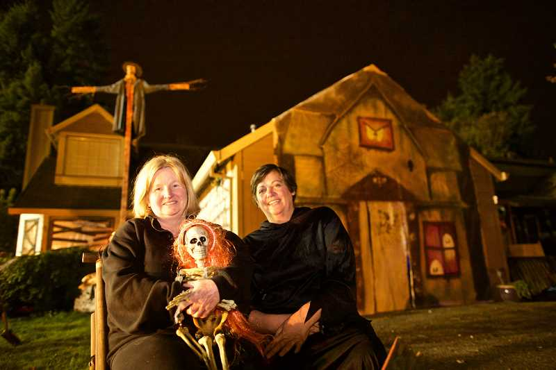 TIMES PHOTO: JAIME VALDEZ - Next-door neighbors Jan Velardi and Suzanne Parker, sit in front of Parkers home where they host a haunted house.