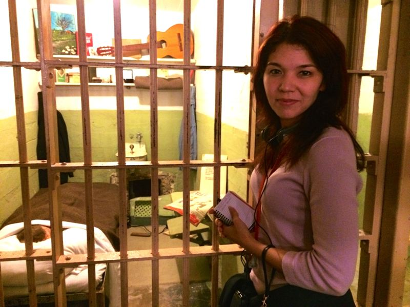SUBMITTED PHOTO - Happy Valley author Kristina McMorris stands outside the cell of an escapee, which is part of the tour of Alcatraz, the former federal penitentiary in San Francisco Bay.