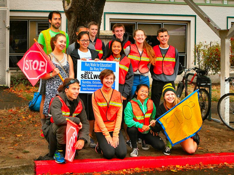 DAVID F. ASHTON - Some of the Cleveland High School Cross Country team members volunteered to help manage traffic flow, and keep people safe at intersections.
