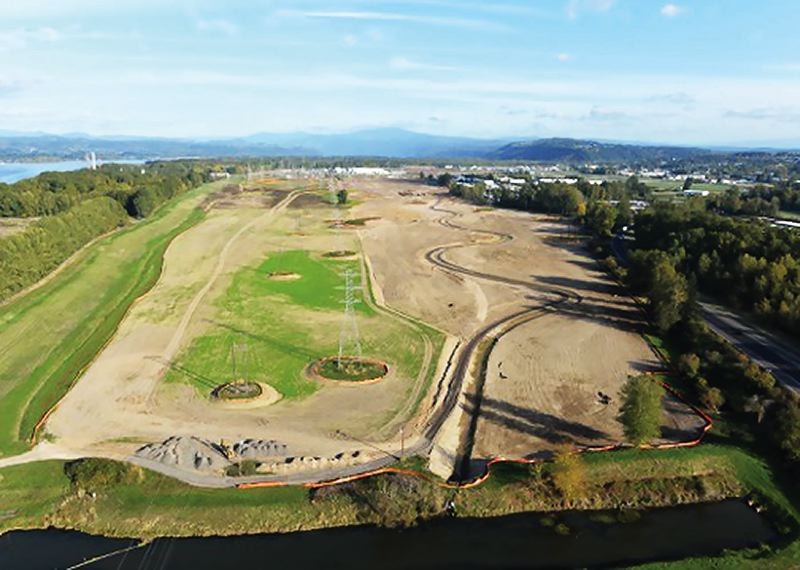 OUTLOOK PHOTO: QUINTON SMITH - Looking east, an aerial view shows the 90-acre wetlands restoration project by the Port of Portland that will be finished early next year to mitigate for creating about 250 acres of industrial land on the former Reynolds Metals property in Troutdale.