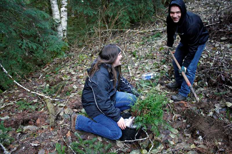 POST PHOTO: KYLIE WRAY - Sandy High School sophomores Morgan Seipert and Matthew Johnson help plant seedlings on Saturday.