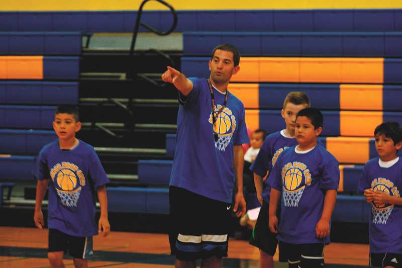INDEPENDENT FILE PHOTO: PHIL HAWKINS - New girls head basketball coach Kyle Buse has been a part of the Gervais sports scene for years, including running summer youth camps at Gervais High School with help from the varsity players.