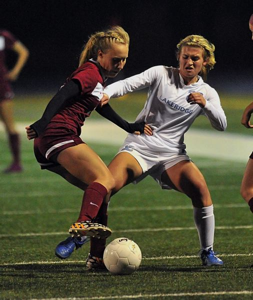 VERN UYETAKE - Natalie Bristol battles for a ball during Lakeridge's narrow victory over Forest Grove.