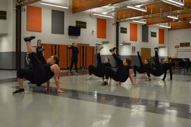 SPOTLIGHT PHOTO: NICOLE THILL - Members of the Scappoose Vision Dance team rehearse their hip hop routine in the gym of Scappoose High School on Tuesday, Dec. 2. The team has been practicing for competition season since mid-October, with practices at least three nights a week.