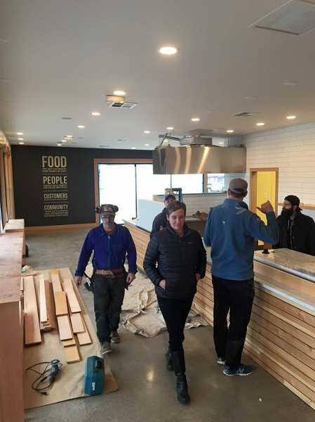 COURTESY: GRAND CENTRAL BAKERY  - Piper Davis, culinary director for Grand Central Bakery, walks through the retailer's new location in Cedar Mill during the construction. The new bakery will open for business Wednesday, Dec. 9.
