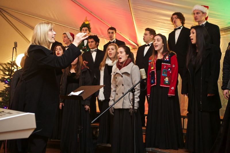 TIMES PHOTO: JAIME VALDEZ - Kim Kroeger, Tualatin High School choir director, leads the choir during the annual Starry Nights & Holiday Lights celebration at the Lake of the Commons last Friday.