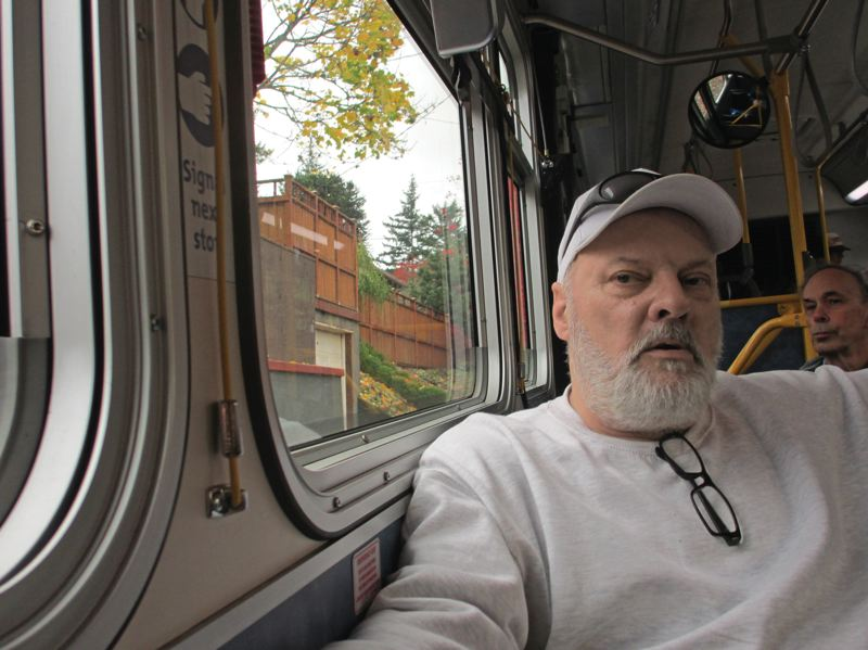 TRIBUNE PHOTO: PETER KORN - An hour out of prison, Rodney K. has a lot to think about on the TriMet bus heading toward downtown, including where he will sleep tonight.