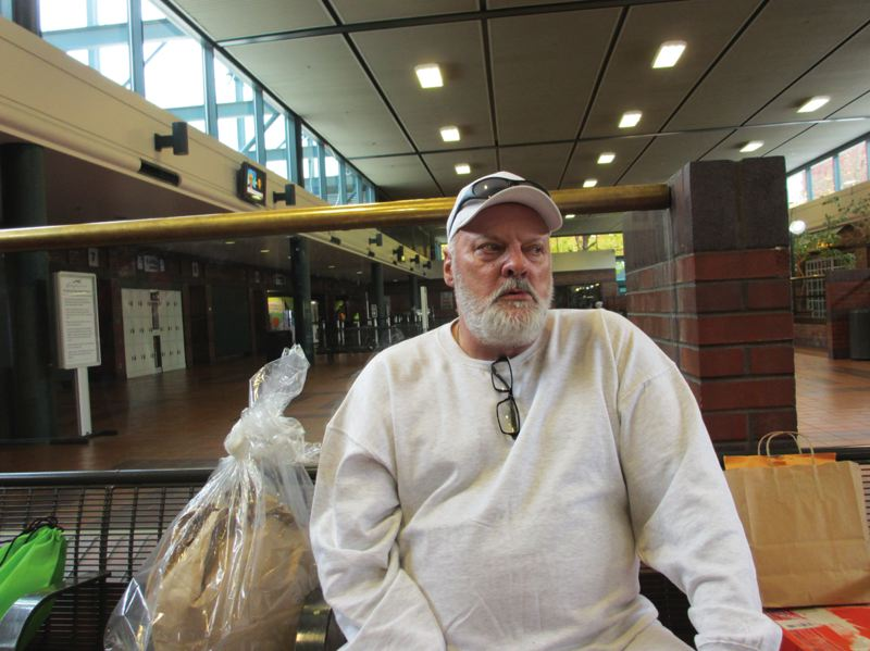 TRIBUNE PHOTO: PETER KORN - Temptation is just a few feet away as Rodney waits inside the Greyhound station for his bus to Lane County.