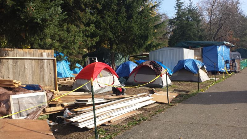PORTLAND TRIBUNE PHOTO: JOSEPH GALLIVAN - Forgotten Realms is a bigger homeless camp next to Hazelnut Grove, both occupying a parcel of city-owned land along North Greeley Avenue beneath Interstate Avenue.