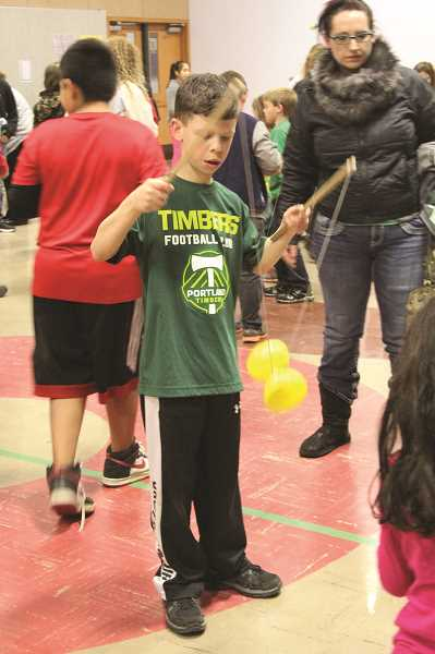 LINDSAY KEEFER - A student tries out the Chinese yo-yo.