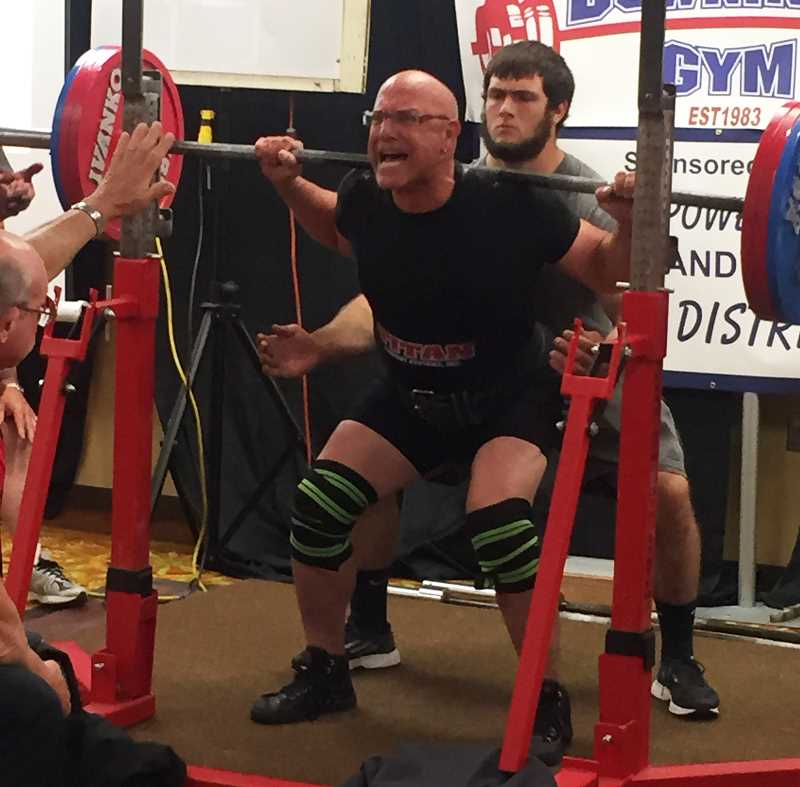 Pamplin Media Group - Garvis sets Powerlifting records