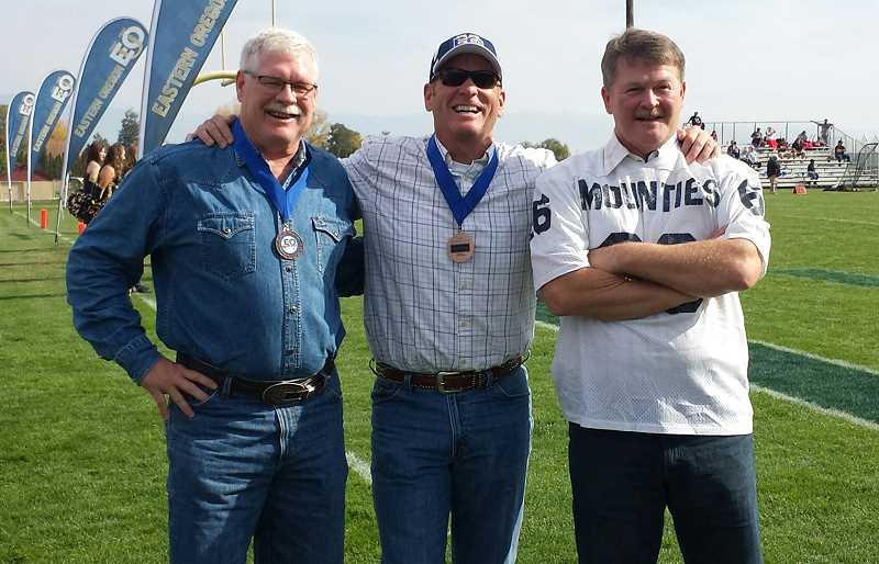 PHOTO COURTESY OF HANK SIMMONS - The three 'Cartwrights', from left, Hank Simmons of Prineville, Wayne Herron of Elgin and David James of Pendleton, pose for a photo after the 1980 Eastern Oregon University football team was inducted into the school's sports hall of fame. Herron is also in the hall of fame as an individual.