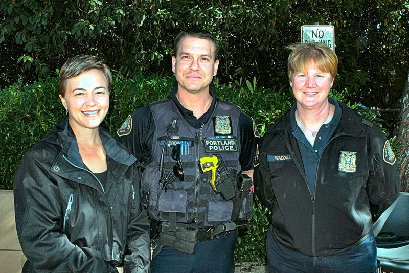 DAVID F. ASHTON - ONI Crime Prevention Specialist Jenni Pullen, spends a moment with PPB Neighborhood Response Team Officer Rob Brown, and Detective Division Cheryl Waddell.