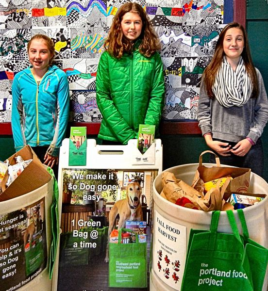 ELIZABETH USSHER GROFF - Winterhaven Elementary School in the Brooklyn neighborhood is one of several schools collecting non-perishable food for the Portland Food Project. Shown are three of Winterhavens participating students, from left: Ava Doherty, Luci Doherty, and Anna Notti.