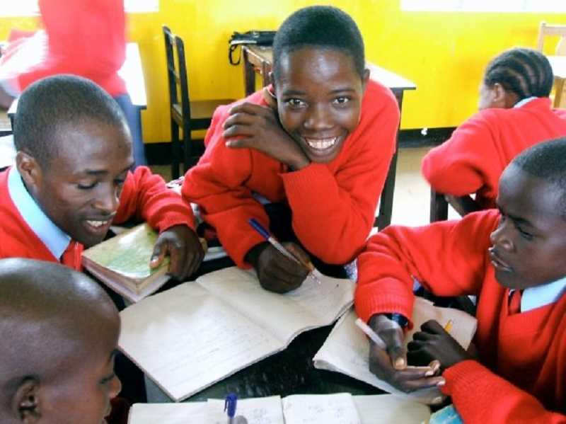 (Image is Clickable Link) Maasai boys have big smiles while they study at the Orkeeswa School. The Red Sweater Project has opened up a whole new world for them.