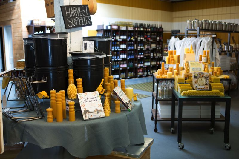 PHOTOS BY ALVARO FONTAN - Beeswax candles and gift sets featuring honey-based personal care products are displayed at Bee Thinking on Southeast Poplar in Portland.