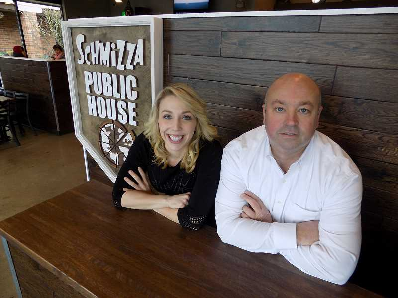 GAZETTE PHOTO: RAY PITZ - Brittaney Mumby, general manager of Schmizza Public House, and owner Mark Satterwhite are excited about the opening of their new restaurant, only the third of its kind in the state, and the second best performing of 28 Pizza Schmizzas.