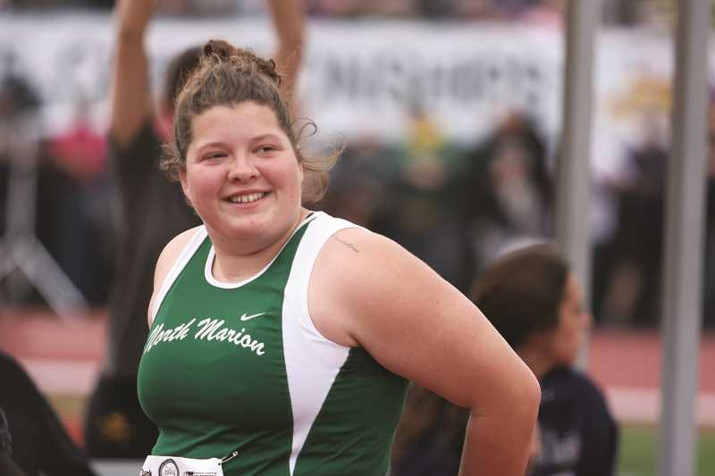 INDEPENDENT FILE PHOTO - Angela Sprecher set a new school record in the shot put, as she and teammate Marisa Jones gave the Huskies their best finish at the state meet in more than a decade.