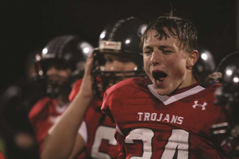 PHIL HAWKINS - Kennedy's Owen Seiler celebrates the Trojans trip to the state finals.