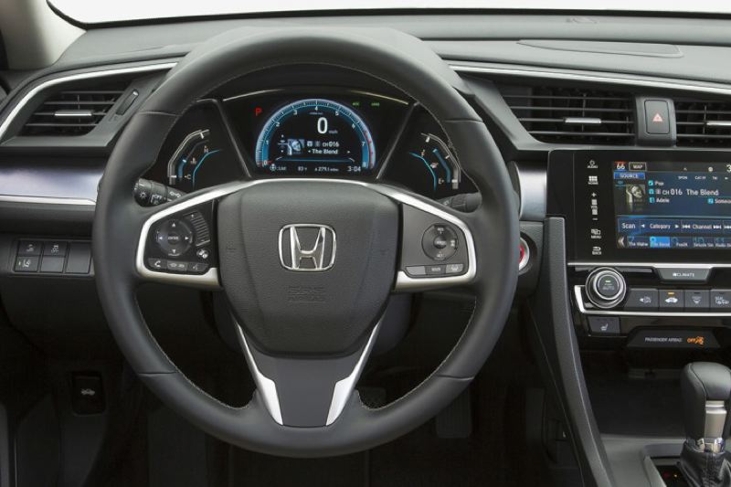 HONDA NORTH AMERICA - At last, a real dash for the 2016 Honda Civic, not the odd-looking split-level version.