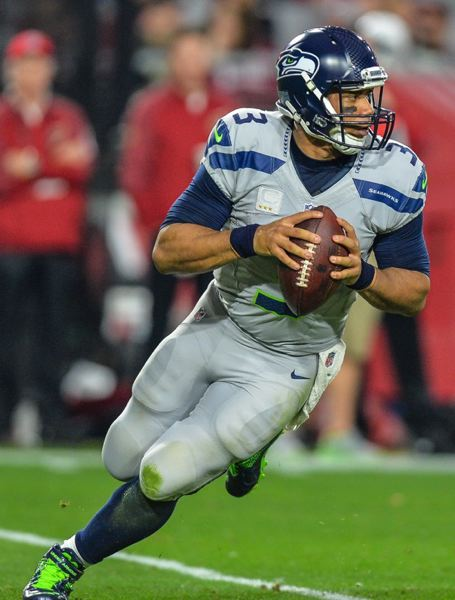 Seahawks QB Russell Wilson rolls out to pass.