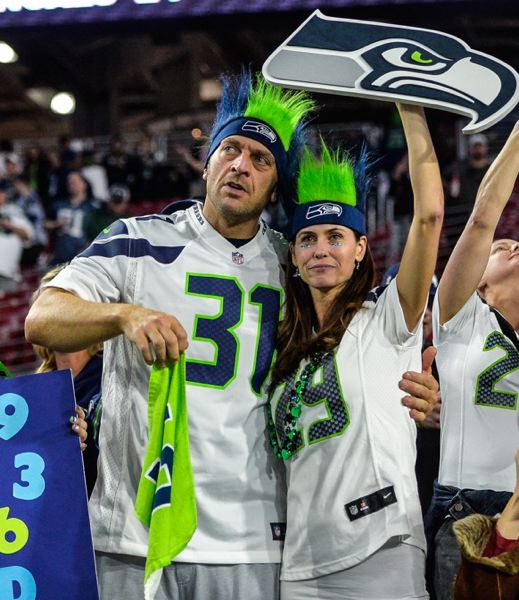 A couple of Seahawks fans enjoys the action in Glendale, Ariz.