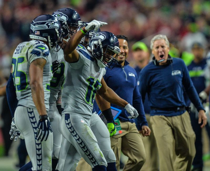 Seattle coach Pete Carroll (right) likes what he sees from return man Tyler Lockett.