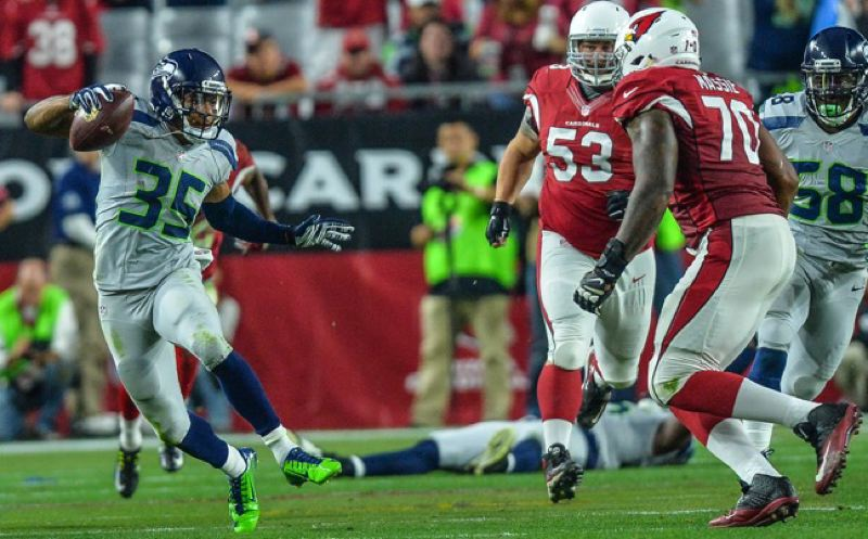 Portland State product DeShawn Shead returns an interception 40 yards for the Seahawks.