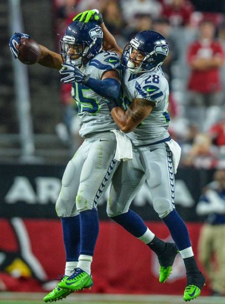 DeShawn Shead (left) gets congratulations from Seattle teammate Marcus Burley.