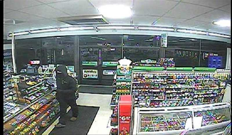 COURTESY WOODBURN POLICE DEPARTMENT - This video footage from Woodburn 7-Eleven shows a masked gunman robbing the store in the early hours of Jan. 1.