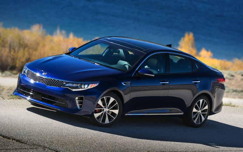 PORTLAND TRIBUNE PHOTO: JOHN M. VINCENT - Though the 2016 Kia Optima has grown in length, width and height, it retains its sweeping coupe-like profile. Interior and cargo room are both improved with the new model.