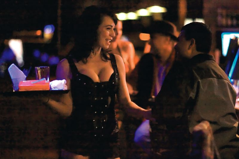 PHOTO COURTESY: LISA ROSS - Server Karli Hebisen chats with a customer at Stars Cabaret in Tualatin.