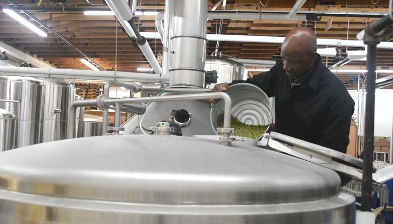 COURTESY: GILGAMESH BREWING - A new, limited-edition craft beer - named Terry Porter, after the Trail Blazers legend checking on the process in Salem - will benefit Doernbecher Children's Hospital Foundation's guest-house facility project.