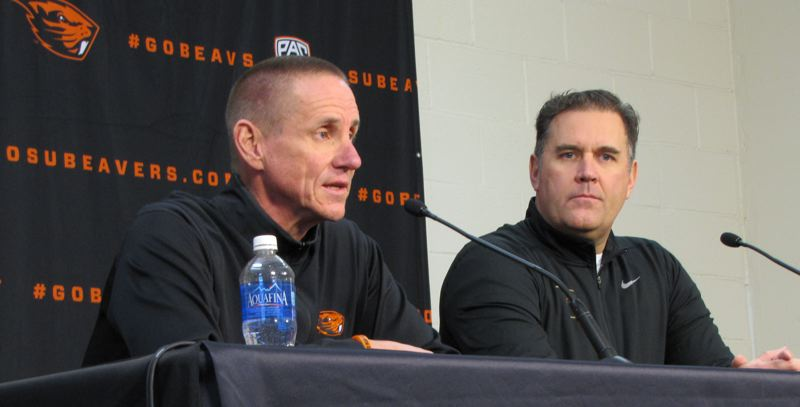 COURTESY: OREGON STATE UNIVERSITY - Oregon State football coach Gary Andersen (left) talks about his new defensive coordinator, Kevin Clune (right), at a Friday press conference in Corvallis.